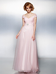 Une ligne de robe de tulle à finition au sol à l'épaule avec crystal by ts couture®